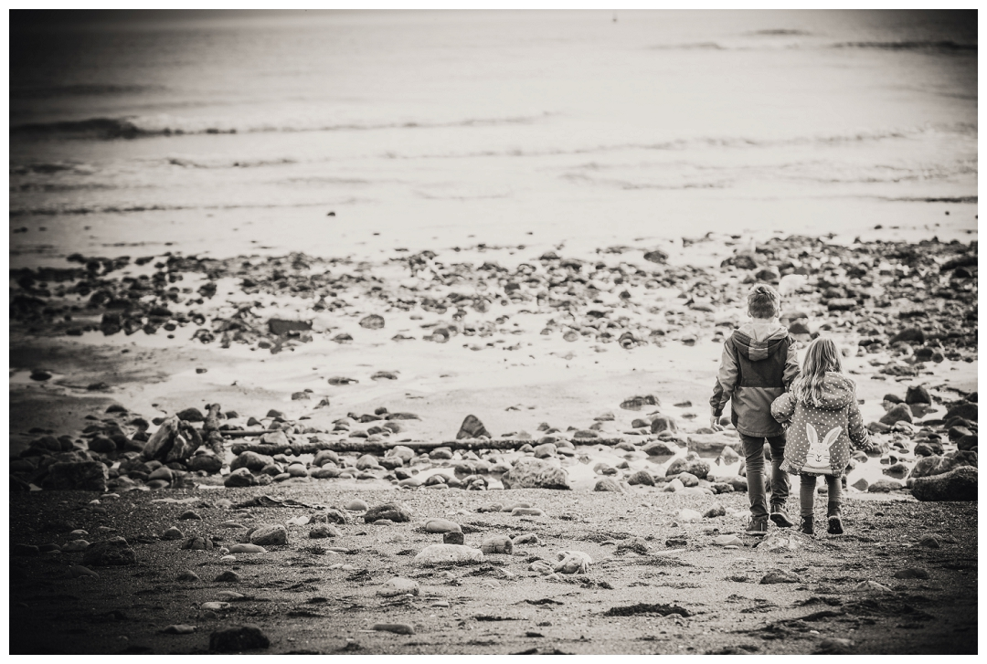 black adn white portraits on teh beach of brother and sister at Teignmouth