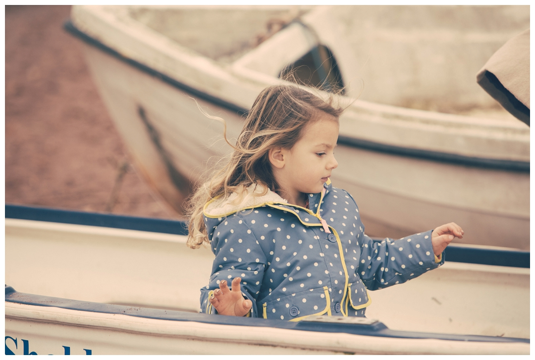 photographs of a girl in a boat, child portraiture Devon